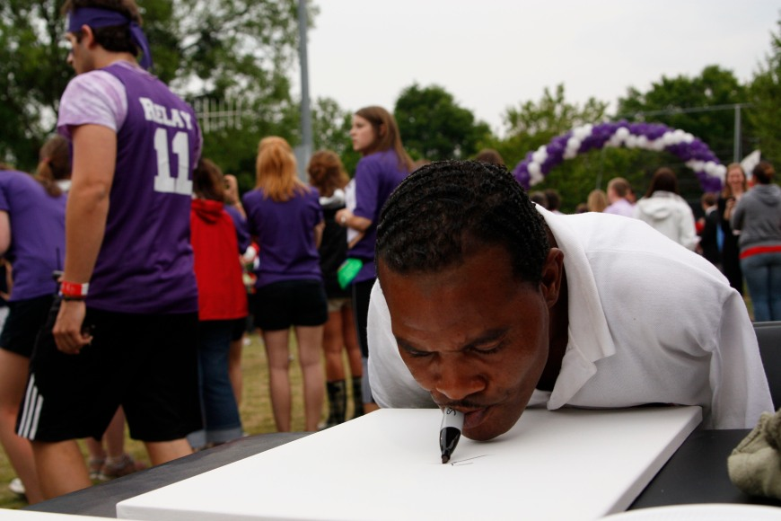 Michael Leon Davenport, 44,  paints at the Relay for Life celebration at the University of Georgia in Athens, Ga., on April 15, 2011. Davenport's father died of prostate cancer, so he donated paintings to be auctioned off to benefit Relay for Life in his honor. © Sarah Osbourne, Sarahkoz2@gmail.com