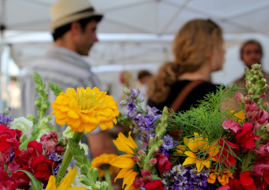 Shoppers enjoy locally grown flowers and produce at the Athens Farmers Market in Athens, Ga., on May 24, 2011. This farmers market emphasizes the importance and benefits of eating locally and organically grown food. © Sarah Osbourne, Sarahkoz2@gmail.com