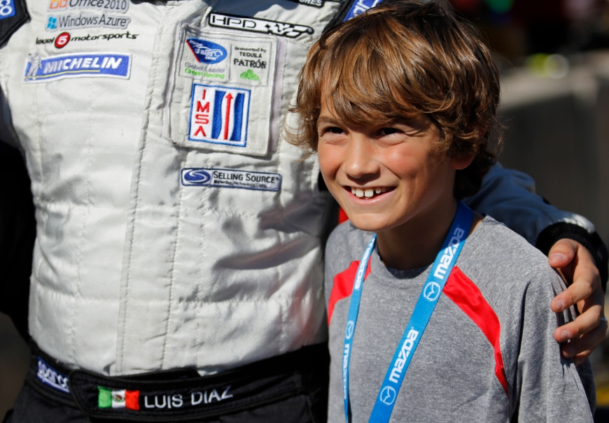 Driver Luis Diaz of Level 5 Motorsports, greets fans on pit road before the Petit Le Mans race begins at Road Atlanta, in Braselton, Ga., on Saturday, October 1, 2011. (© Sarah Osbourne, Sarahkoz2@gmail.com)