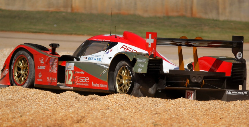 Car number 12, the Lola B-10/60-Toyota, of team Rebellion Racing, in class LMP1-ILMC, after it skid off the road at Turn 5 at Petit Le Mans at Road Atlanta, on Saturday, October 1, 2011. (© Sarah Osbourne, Sarahkoz2@gmail.com)