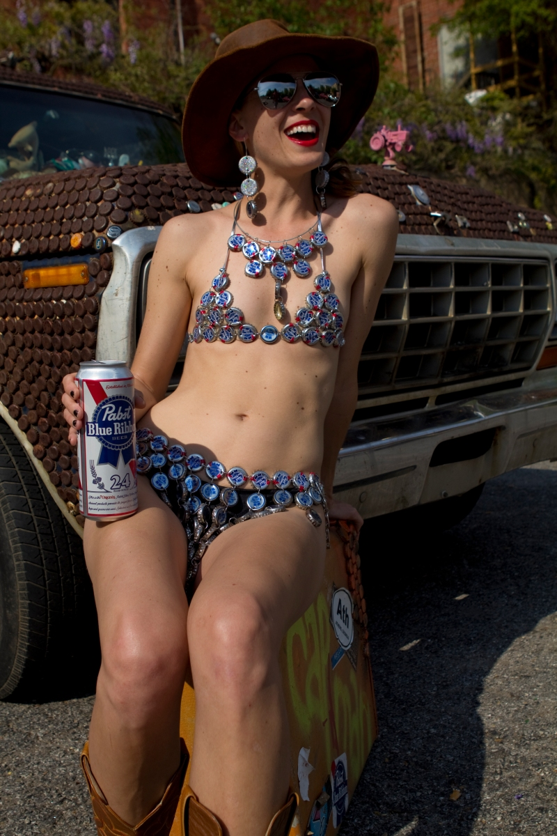 "Beth Weigle models the PBR bottle cap bikini made by artist Jimmy Straehla, also known as, ""The Cap Man."" © Sarah Osbourne, Sarahkoz2@gmail.com"