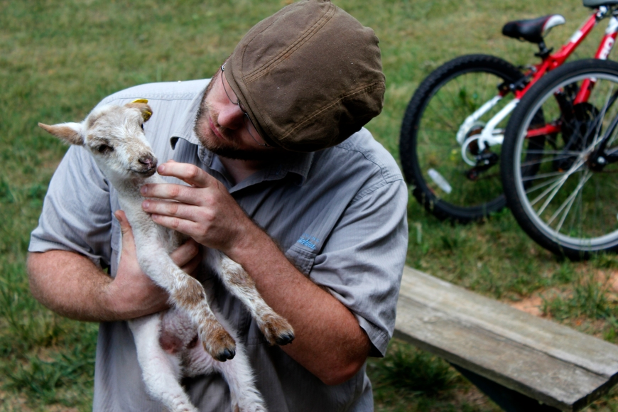 "A Farmer For a Day participant holds a baby lamb named, ""Bon Bon,"" at the Farmer For a Day event at Darby Farm in Good Hope, Ga., on Saturday, April 28, 2012. (© Sarah Osbourne, Sarahkosbourne@gmail.com)"